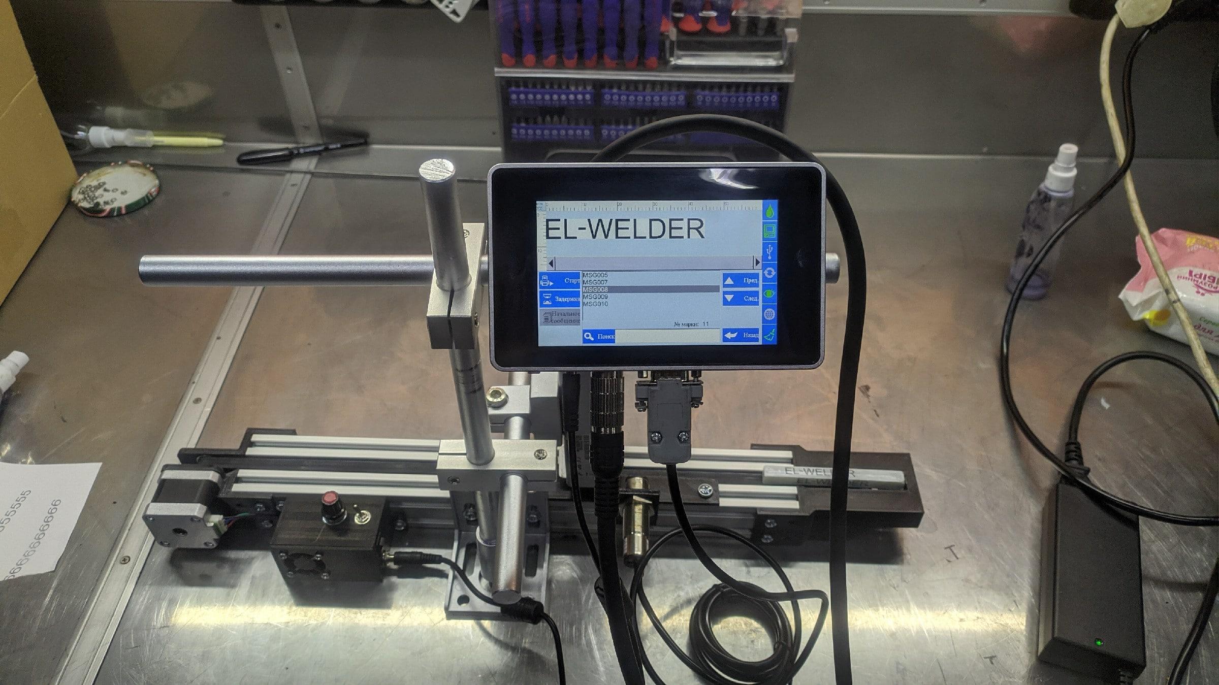 Микроконвейер разработки компании Elengi с маркиратором Sojet Elfin 1S